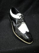"Greenspan's carries Stacy Adams in the wingtip (Dayton) style, the cap toe ""biscuit"" style, (Madisons) and the patent shiny solid color (Concordes)."